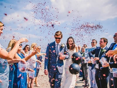 Wedding photographs taken on East Looe beach following the ceremony in the Guildhall Chamber. (Image by courtesy of Barney Walters Photography)