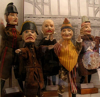 Early puppets used by wandering street merchants